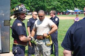 One of our servicemen getting ready to climb Ladder 77.