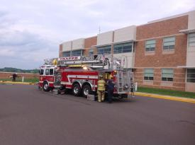 Ladder 77 in position at the High School